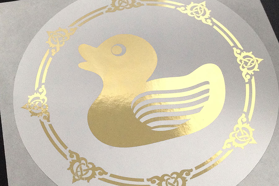Metallic gold duck on white paper sticker label